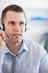 Close up call center agent looking for a solution