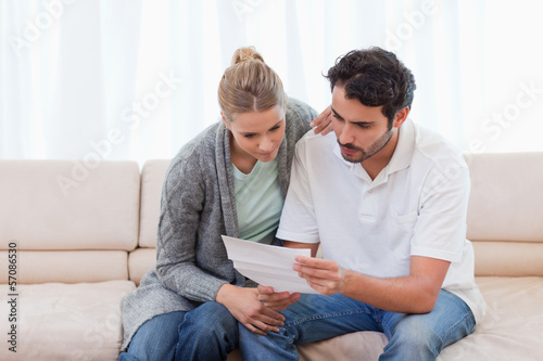 Focused couple reading a letter