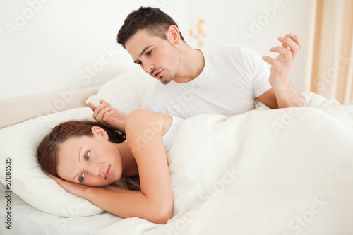 Unhappy couple in their bed