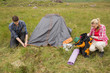 Couple pitching their tent