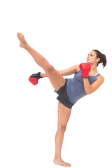 Attractive sporty brunette kick boxing
