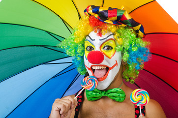 Clown with umbrella and lollypop