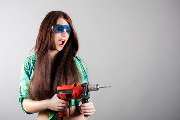 sexy woman with power drill