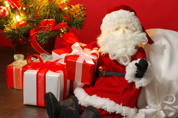 Stuffed toy Santa Claus and many Christmas presents.