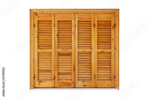 Wooden window with shutters closed isolated on white