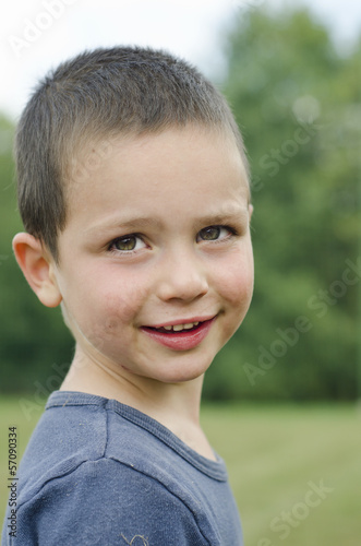 Smiling child portrait outdoors