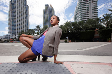 Woman kneeling on the streets of Miami Beach