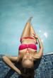model wearing bikini at the swimming pool