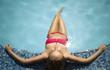 female wearing bikini at the swimming pool,