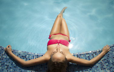 female wearing bikini at the swimming pool,