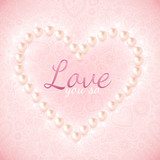 Light pink ornate background with pearly heart