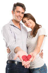 Loving Couple Showing Painted Heart On Hand