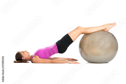 Woman Exercising With Pilate Ball