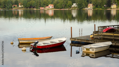 Three boats at wooden pier