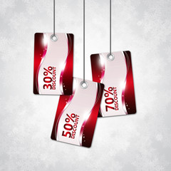shiny discount cards over christmas background