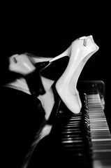 white shoes on an upright piano