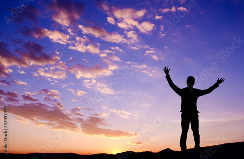 Freedom concept, businessman standing on top mountain