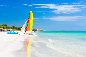 Scene with sailing boat at Varadero beach in Cuba