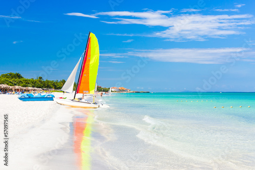 Fotobehang Caraïben Scene with sailing boat at Varadero beach in Cuba