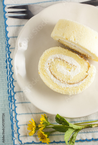 Two vanilla roll cake on the blue stripe clothes
