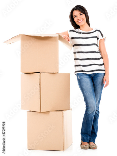 Woman packing in boxes
