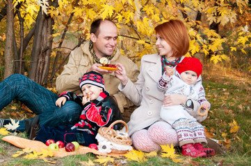 Family picnic. Family of four in the autumn forest
