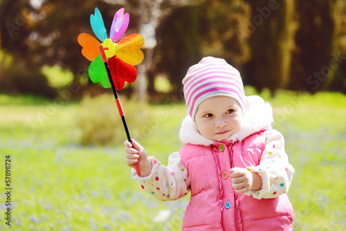 toddler  with windmill
