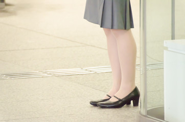 legs of a business woman