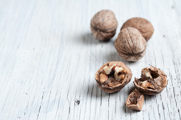 Walnuts wooden background