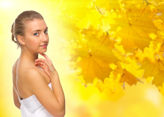 Young girl on autumnal background