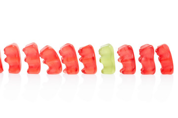 Gummy bears candies row on white, clipping path