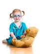kid playing doctor with toy