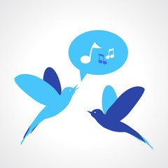 Two blue birds, one singing