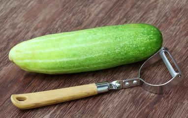 Fresh cucumber with peeler
