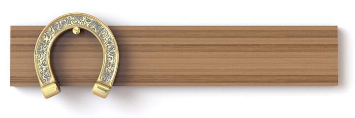 Golden horseshoe on a wooden board