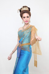woman posing with creative chignon hair-style wearing thai dress