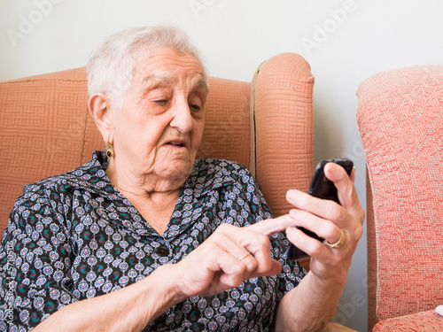 Old lady using a smartphone
