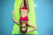 Beautiful   female  wearing bikini at the swimming pool