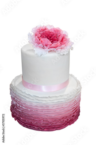 Beautiful wedding cake with pink flower isolated on white