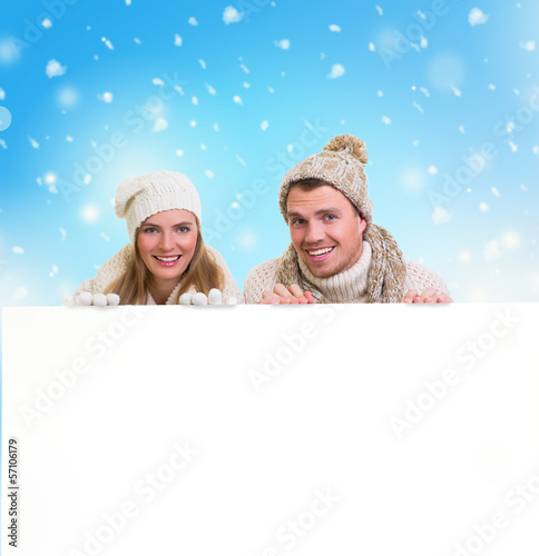 winter couple holding copy space