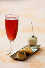 Kir royal coktail with amuse bouche