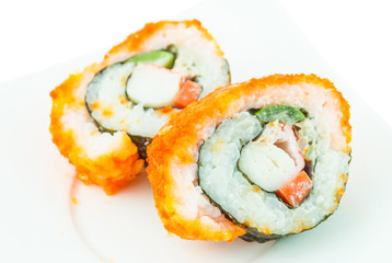 Delicious California rolls on dish