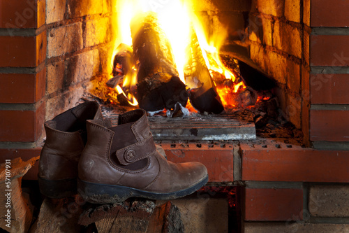 shoes dry near of fire in fireplace