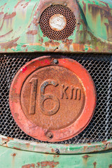 Front view of an old tractor with maximum speed sign