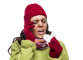 Sick Mixed Race Woman Blowing Her Sore Nose with Tissue.