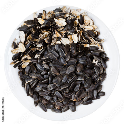 top view of sunflower seeds and husks on plate