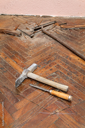 Home renovation parquet floor and crowbar chisel hammer tool