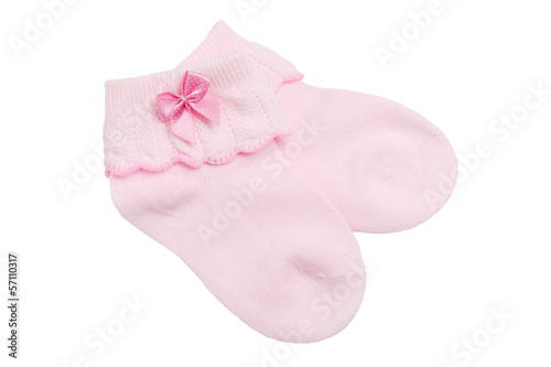 Pink baby socks isolated on white