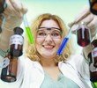 chemist woman with chemical glassware tubes