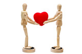 Two wooden dolls/ mannequins holding red heart over a white back
